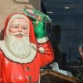 Creepy Father Christmas outside a shop