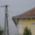 Rain battering Bertha's windows during a powerful thunderstorm