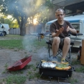 Steve manning the BBQ (and perhaps performing some kind of wafting ritual?)