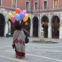 Lady with balloons tied to her hair