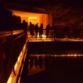 Tourists gather around a lake in a chamber