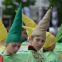 Children in a dragon costume at a carnival (not sure they were particularly enjoying it)