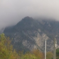 The rain comes in over the mountains